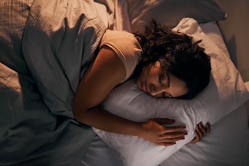 Woman sleeping after getting Oral Appliance Therapy from Atlantic Dentistry in Jacksonville, FL